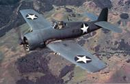Asisbiz Grumman F6F 3 Hellcat color photo showing early paint scheme of Black F36 over California 1943