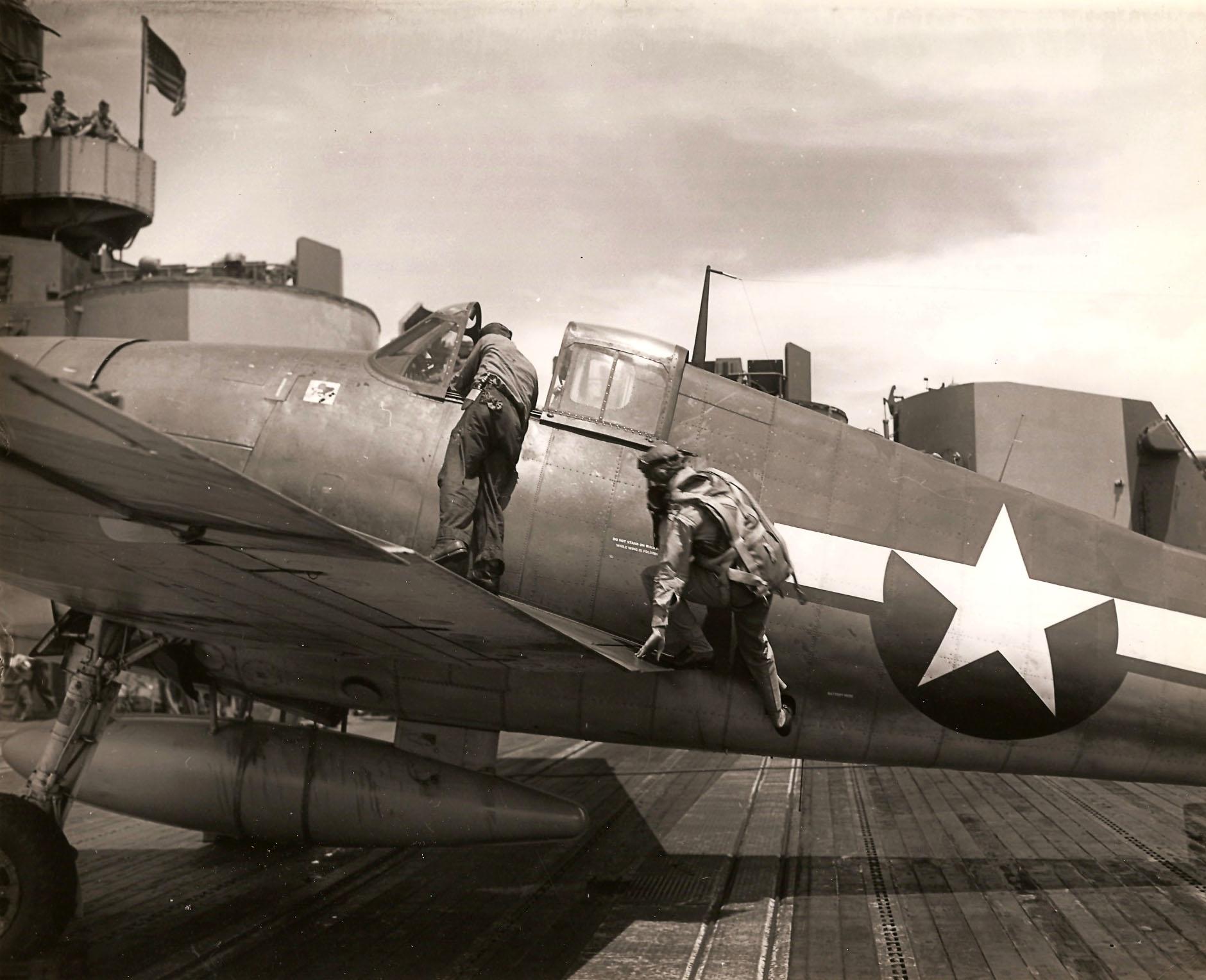 Aircrew USN pilot climbing aboard his Grumman F6F Hellcat 01