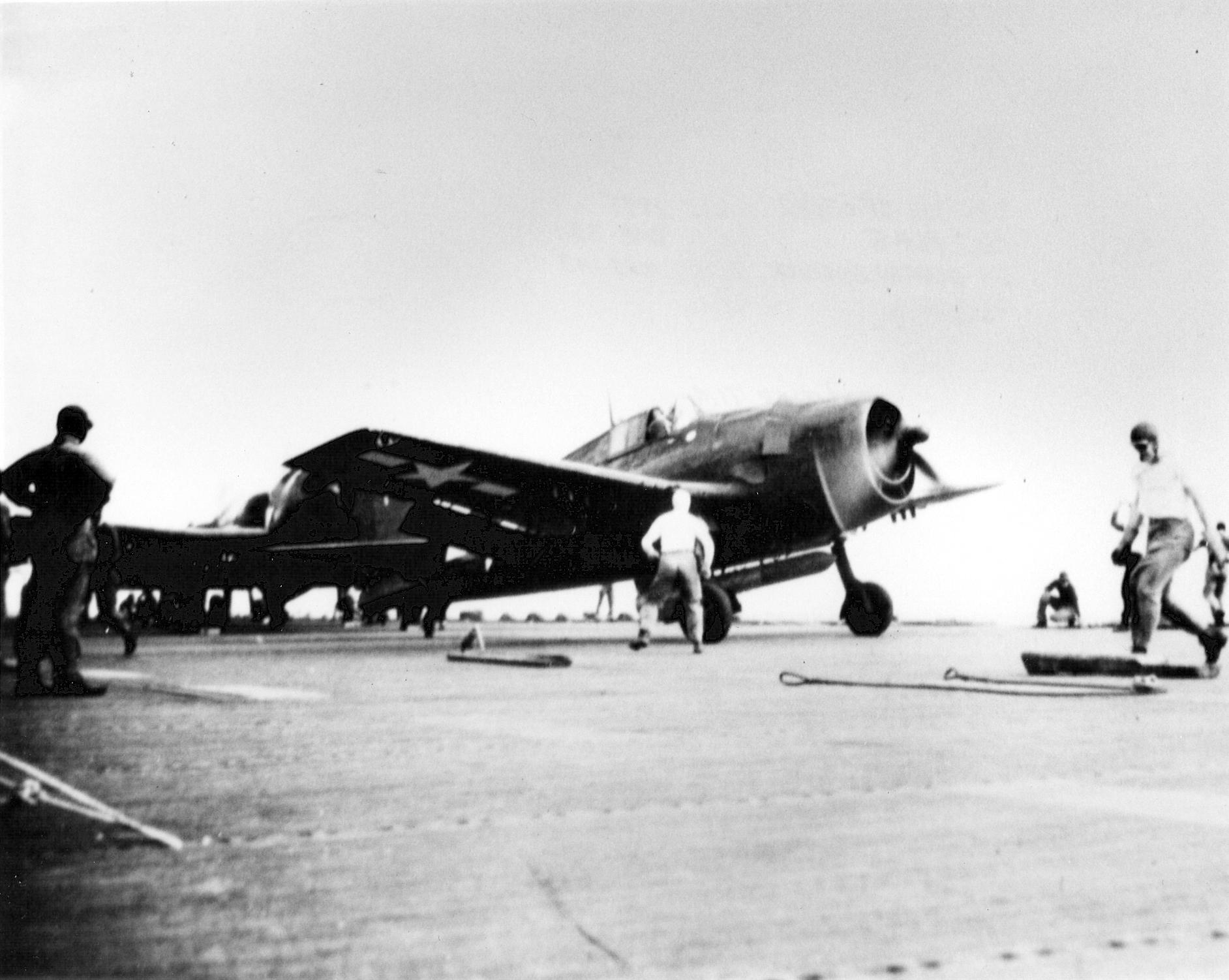 Grumman F6F 5 Hellcat VMF 321 carries a torpedo CVE 113 USS Puget Sound 1945 01