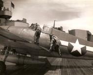 Asisbiz Aircrew USN pilot climbing aboard his Grumman F6F Hellcat 01