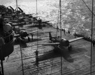 Asisbiz Grumman F6F 5 Hellcat VF 18 White 39 and 21 preparing for launch CV 11 USS Intrepid 1945 01