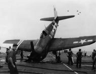 Asisbiz Grumman F6F 5 Hellcat VF 40 White D15 landing mishap CVE 27 USS Suwanee Aug 1945 01