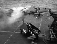 Asisbiz Grumman F6F 5N Hellcat VFN 53 White 7 and 27 after a kamikaze attack CV 3 USS Saratoga 21st Feb 1945 01