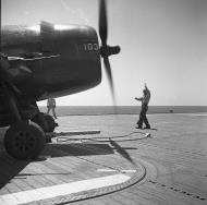 Asisbiz Grumman F6F 5N Hellcat White 103 being prepared for take off 01
