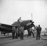 Asisbiz Grumman F6F 5N Hellcat White 107 being prepared for take off 01
