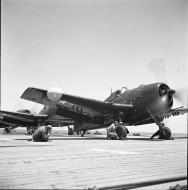 Asisbiz Grumman F6F 5N Hellcat White 18 being prepared for take off 01