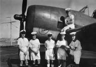 Asisbiz Royal Navy personnel posing against a Helcat 01