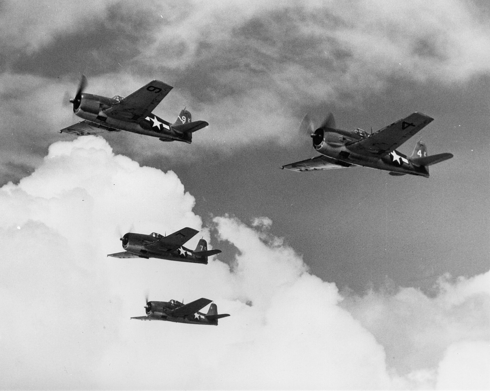 Grumman F6F 3 Hellcat VF 1 White K0, K7, K9 and K4 in formation CV 10 USS Yorktown II June 1944 03