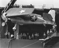 Asisbiz Grumman F6F 3 Hellcat VF 1 White 22 being loaded onto the USS Yorktown 01