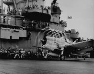Asisbiz Grumman F6F 3 Hellcat VF 1 White K21 launching from CV 10 Yorktown II 1943 01