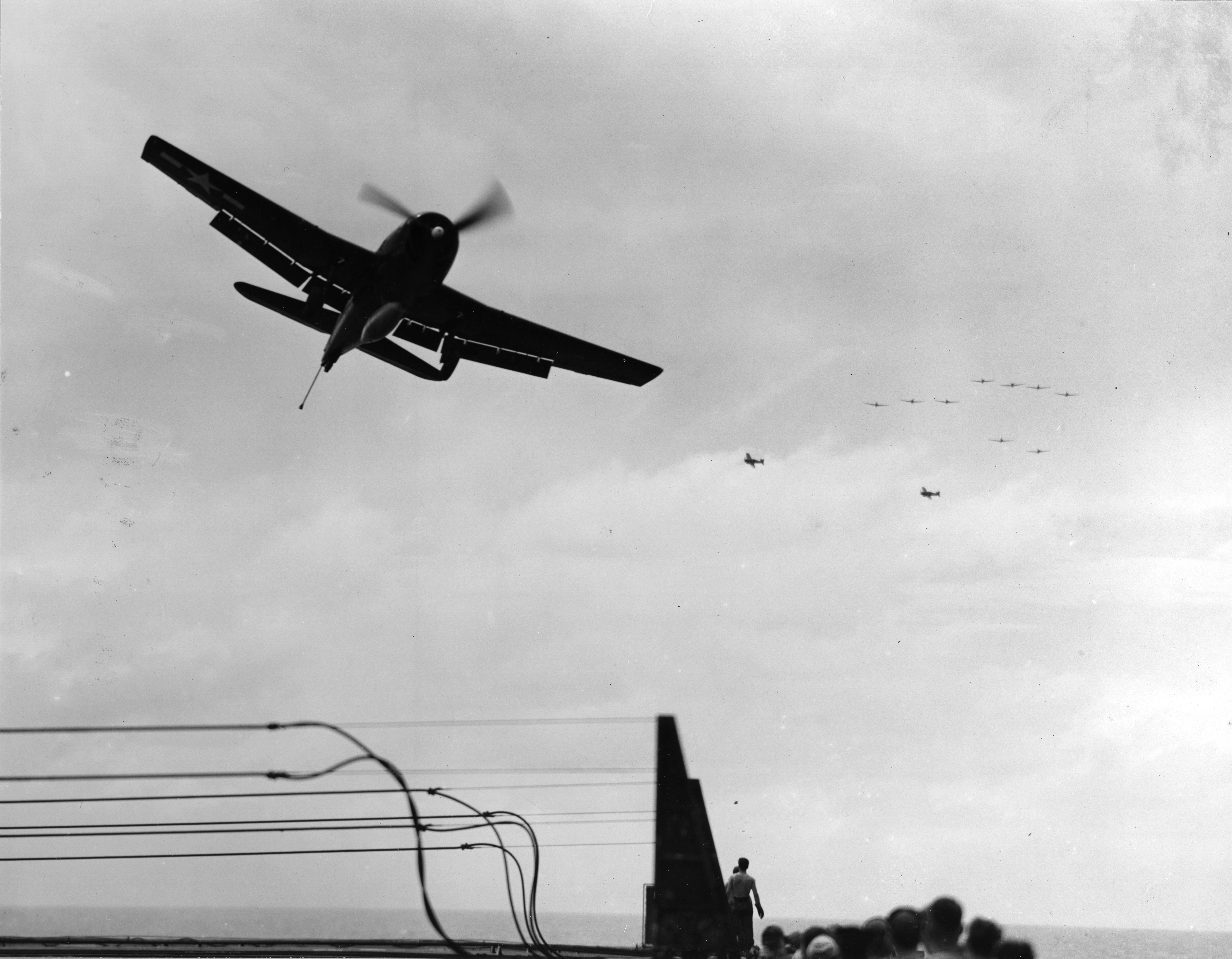 Grumman F6F 5 Hellcat VF 11 Sundowners being waved off CV 12 USS Hornet 1945 01