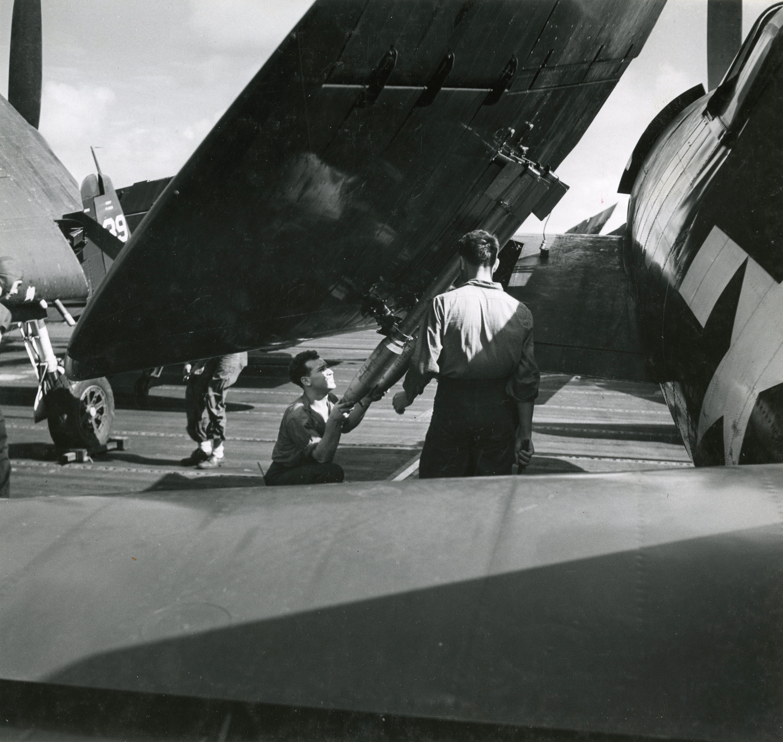 Grumman F6F 5 Hellcat VF 11 ground crew getting the aircraft mission ready CV 12 USS Hornet 1944 03