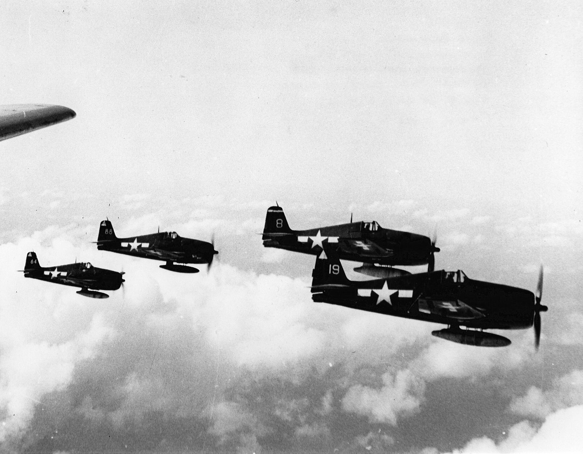 Grumman F6F 5 Hellcat VF 14 and VF 15 escorting ADM Nimitz R4D on flight from Ulithi to Guam 01