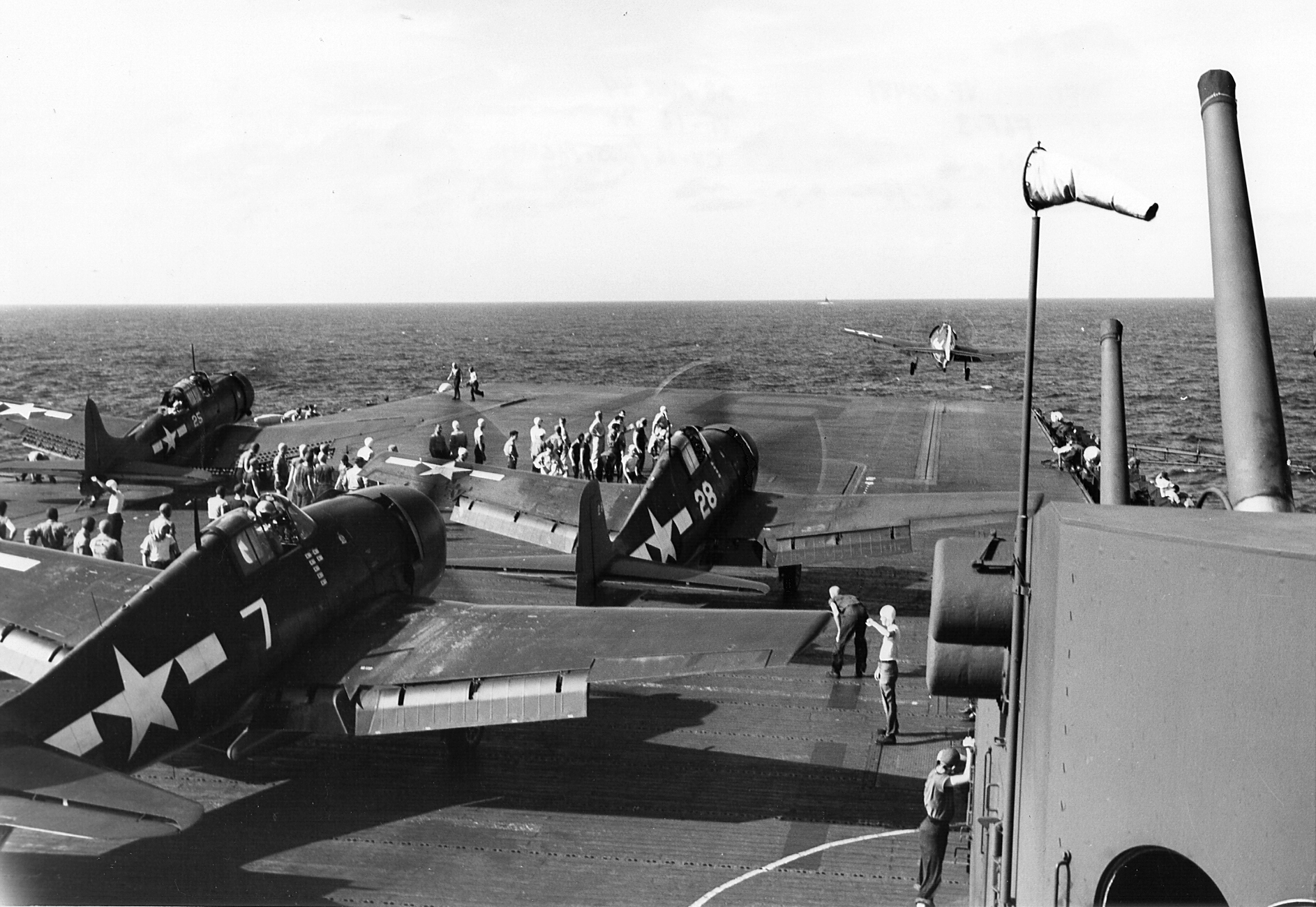 Grumman F6F 3 Hellcat VF 16 White 28 and 7 prepare for launch CV 15 USS Randolph 1944 01
