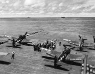 Asisbiz Grumman F6F 3 Hellcat VF 16 White 4 and 18 ready for launch CV 16 USS Lexington 16th Apr 1944 01