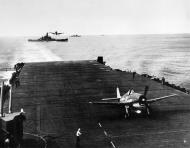 Asisbiz Grumman F6F 3 Hellcats from VF 16 landing CV 16 USS Lexington with BB 57 USS South Dakota 1944 01