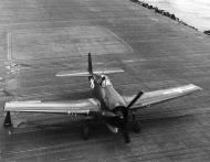 Asisbiz Grumman F6F 3 Hellcat VF 19 White 1 landing aboard CV 16 USS Lexington 1st Sep 1944 01
