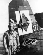 Asisbiz Grumman F6F 5 Hellcat VF 23 White 33 BuNo 77581 flak damaged flown by Bailey CVL 27 USS Langley 1945 01