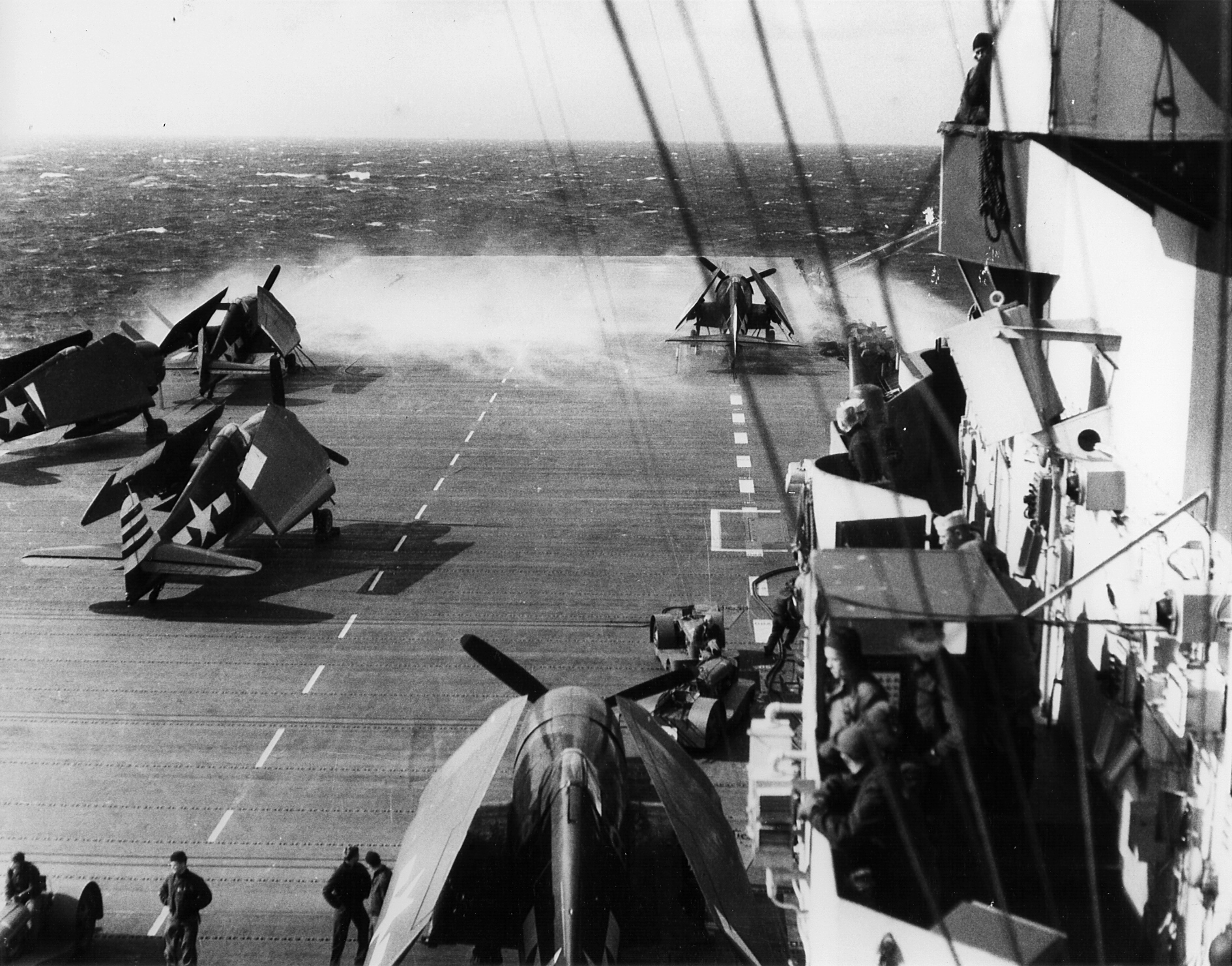 Grumman F6F 5 Hellcats VF 3 and VF 12 are on the deck CV 10 USS Yorktown off Iwo Jima D Day 01