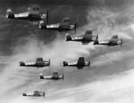 Asisbiz Grumman F6F 3 Hellcat VF 3 Whie E1 flying in formation near San Diego CA 1943 01