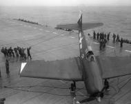 Asisbiz Grumman F6F 5 Hellcat VF 3 White 2 Henry M Rowland lands a battle damaged ac without a tail hook 02