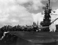 Asisbiz Grumman F6F 3 Hellcat VF 26 White 33 landing aboard CVL 28 USS Cabot 19th Jul 1944 01