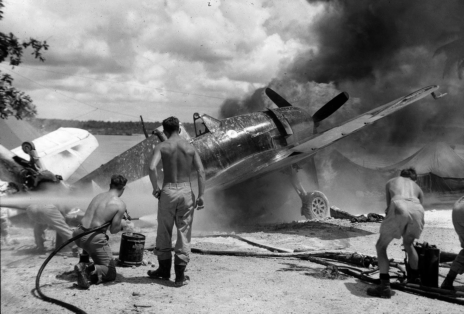 Grumman F6F 5 Hellcat VF 33 on fire at Ondonga Airfield New Georgia 01