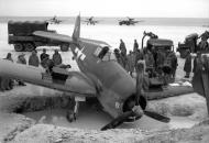 Asisbiz Grumman F6F 5 Hellcat VF 33 White 6 taxing mishap at Barakoma airstrip Solomon Islands 01