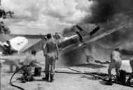Asisbiz Grumman F6F 5 Hellcat VF 33 on fire at Ondonga Airfield New Georgia 01