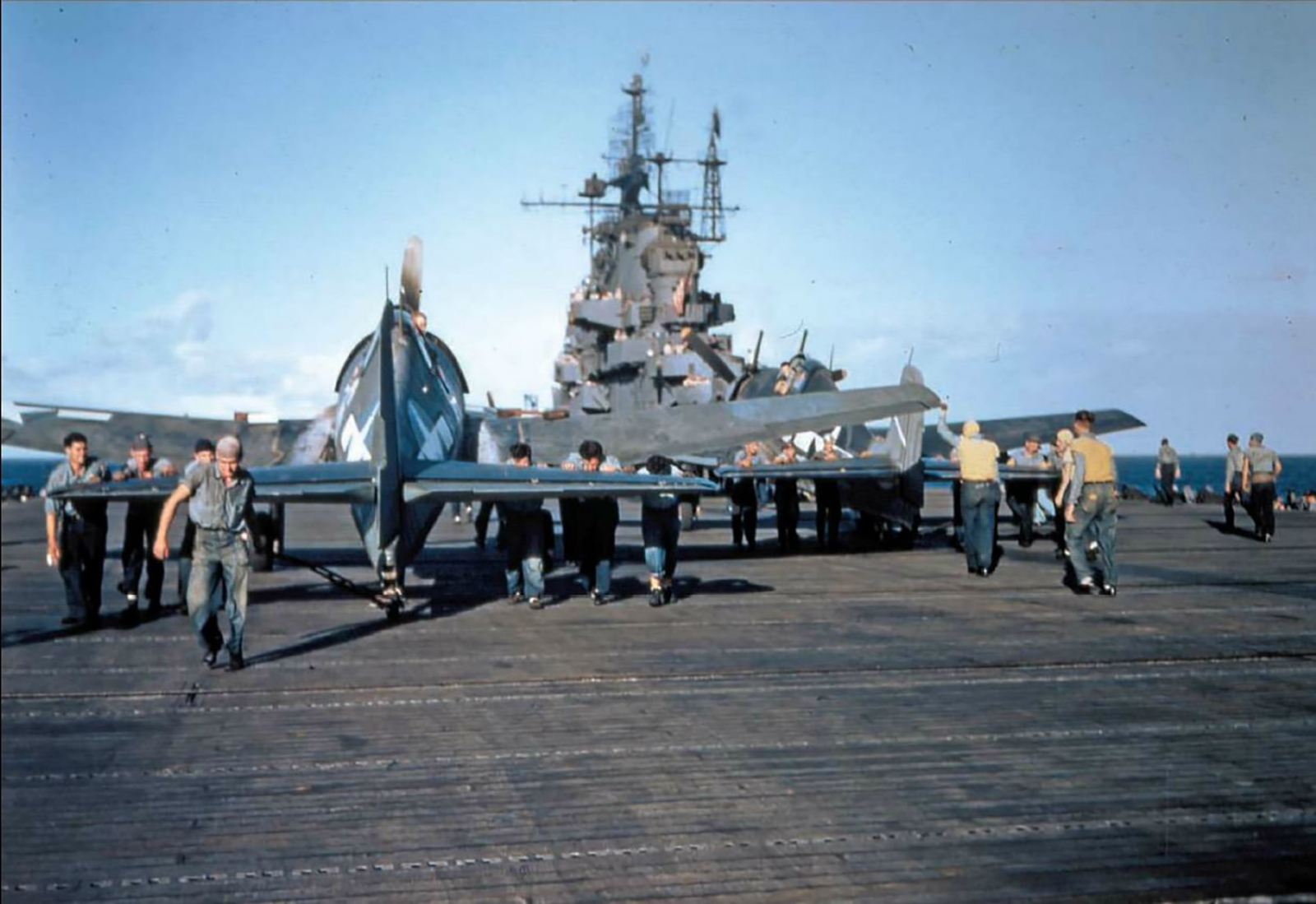 Grumman F6F 3 Hellcat belonging to VF 5 being manouvered by deck crew 01