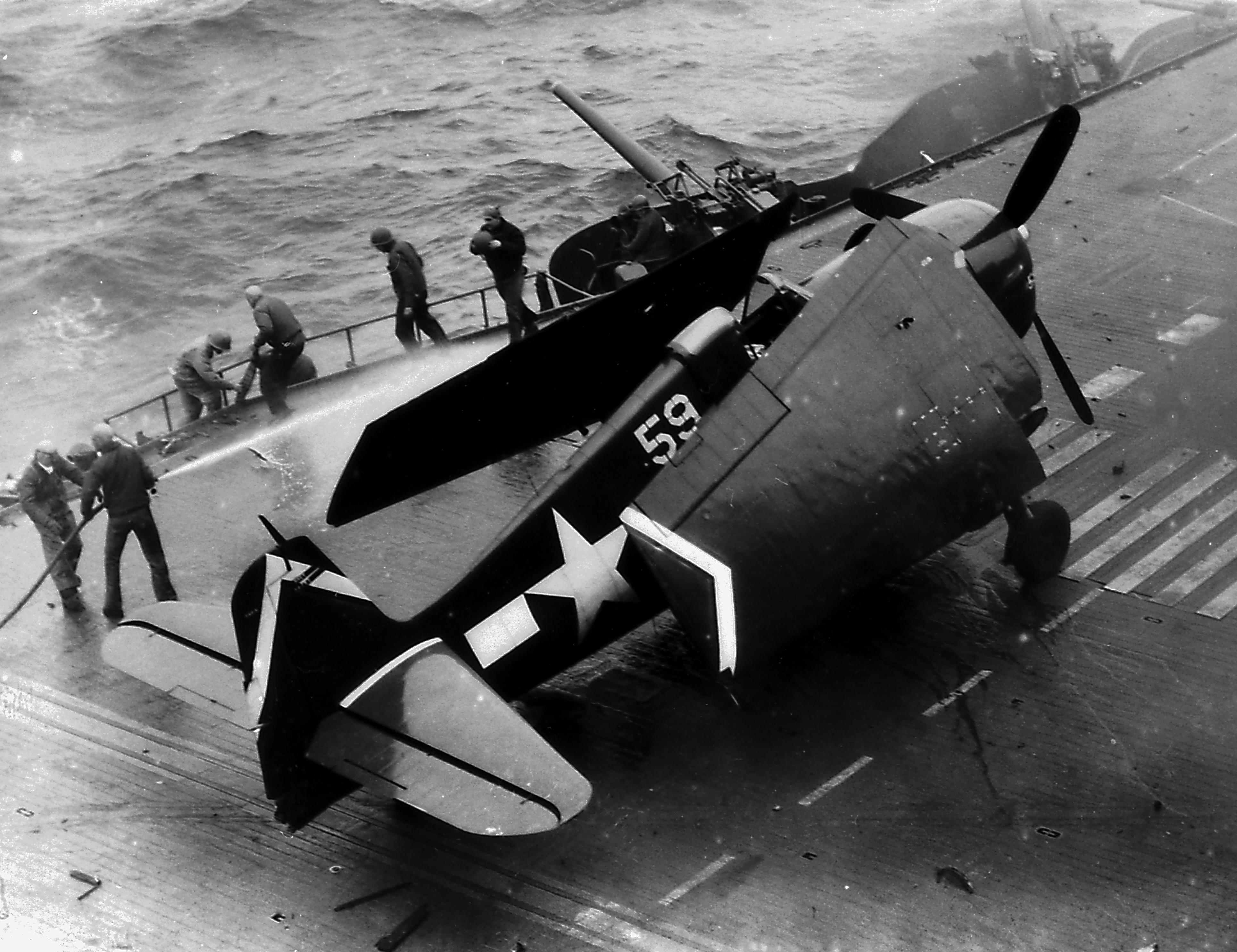 Grumman F6F 5 Hellcat VF 53 White 59 during kamikaze attack CV 3 USS Saratoga 21st Feb 1945 01