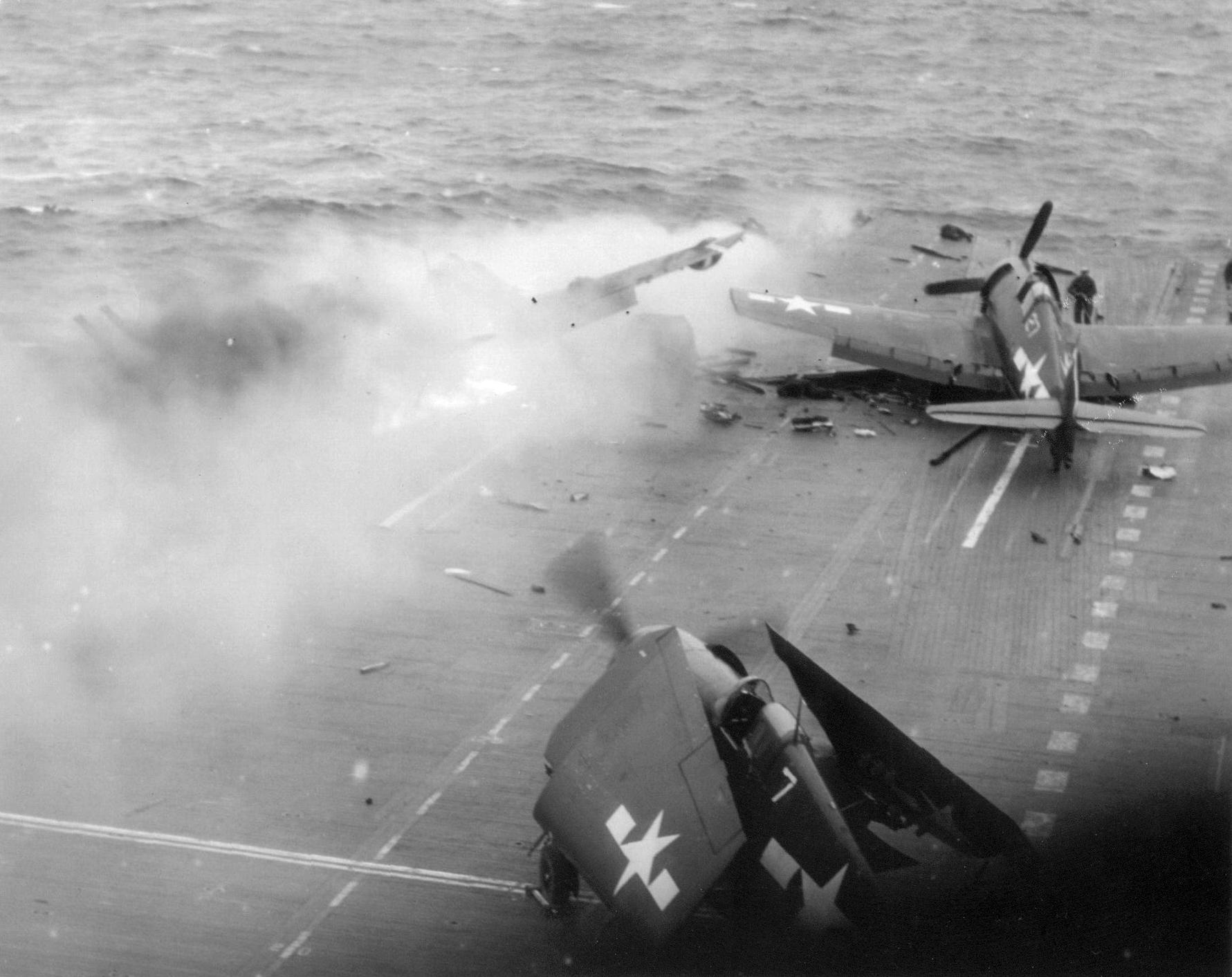 Grumman F6F 5 Hellcat VF 53 White 7 and 27 during kamikaze attack CV 3 USS Saratoga 21st Feb 1945 01