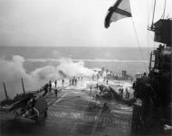 Asisbiz Grumman F6F 5 Hellcat VF 53 White 59 during kamikaze attack CV 3 USS Saratoga 21st Feb 1945 02