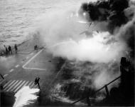Asisbiz Grumman F6F 5 Hellcat VF 53 White 59 during kamikaze attack CV 3 USS Saratoga 21st Feb 1945 04