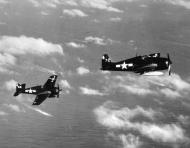 Asisbiz Grumman F6F 5 Hellcat VF 82 White 62 and 72 from CV 20 USS Bennington 1945 areial shot 01