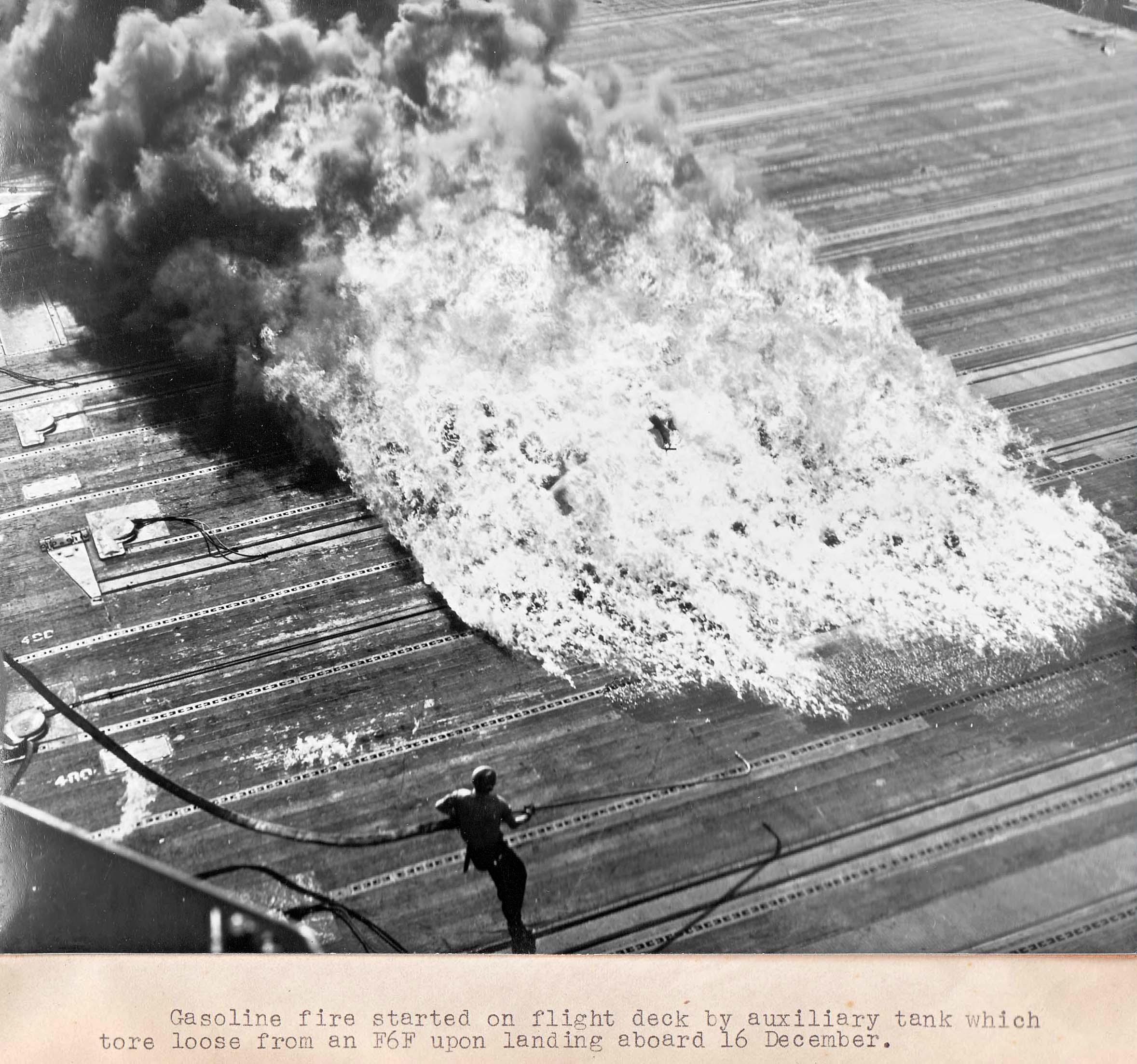 Fire engulfs the USS Essex flight deck after a Hellcats drop tank burst on landing 16 Dec 1944 03