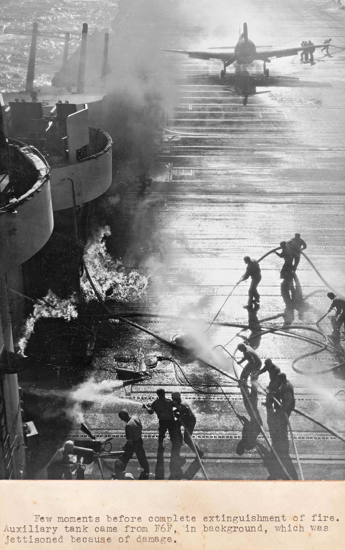 Fire engulfs the USS Essex flight deck after a Hellcats drop tank burst on landing 16 Dec 1944 04