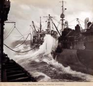 Asisbiz CV 9 USS Essex and T2 SE A1 oiler USS Tallulah AO 50 refueling in heavy seas off Luzon 9 Nov 1944 02