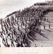 Asisbiz CV 9 USS Essex many hands make light work as crew members clean the flight deck 01