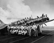 Asisbiz Curtiss SB2C 3 Helldiver VB 4 officers and flt crew aboard CV 6 USS Essex at Ulithi Atoll 1944 01