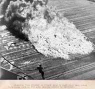 Asisbiz Fire engulfs the USS Essex flight deck after a Hellcats drop tank burst on landing 16 Dec 1944 03