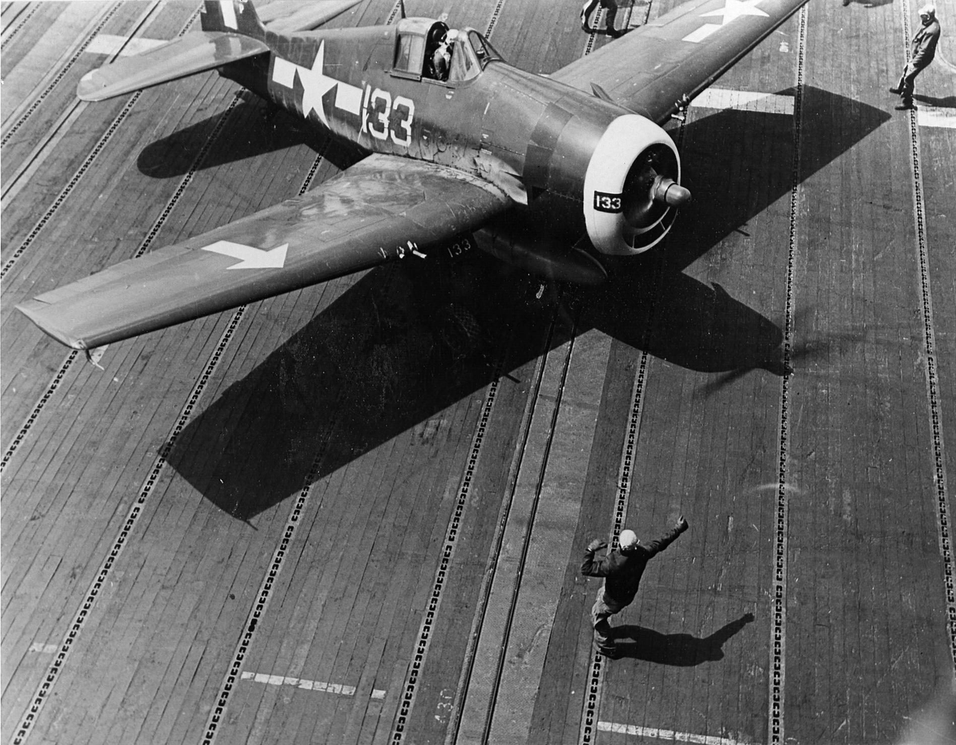 Grumman F6F 5P Hellcats VF 84 White 133 preparing to launch CV 17 Bunker Hill Feb 1945 01