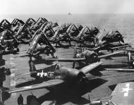 Asisbiz Grumman F6F 5P Hellcats VF 84 White 136 133 preparing to launch CV 17 Bunker Hill Feb 1945 01