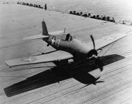 Asisbiz Grumman F6F 3 Hellcat VF 9 White 13 landing aboard CV 9 USS Essex 25th Mar 1945 01
