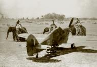 Asisbiz A group of elephants and their riders walking past a RAF Hurricane IIc B 01