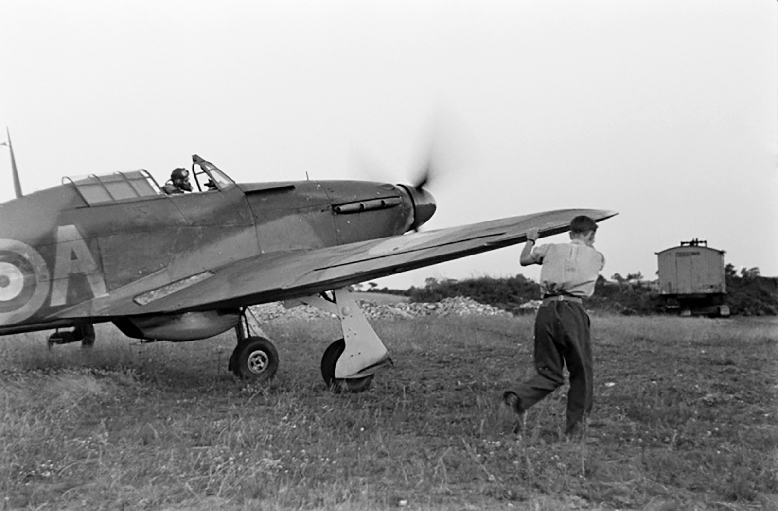 Hawker Hurricane IIa RAF being guided by ground crew as it taxis 1940 01