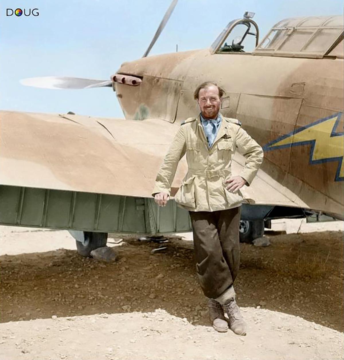 Aircrew RAF 274Sqn FlLt Dudley SG Honor poses by a Hurricane at Gerawala Egypt 01