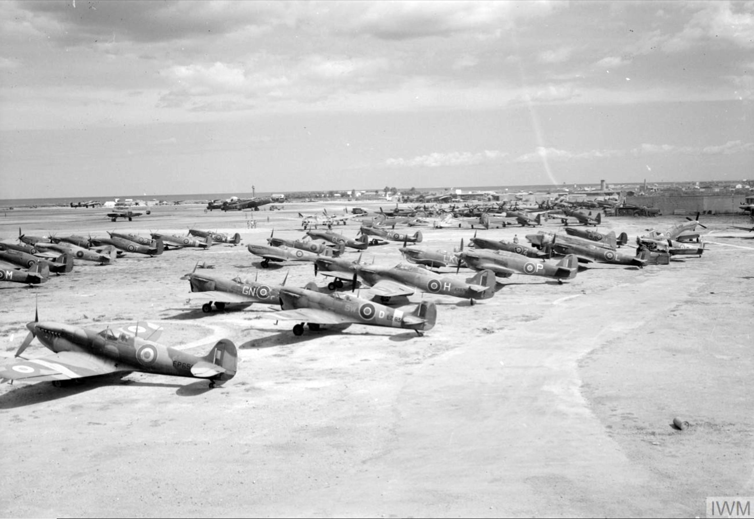 Hurricanes at RAF 110 Maintenance Unit with 185Sqn GLK Brindisi Italy 1943 IWM CNA3285
