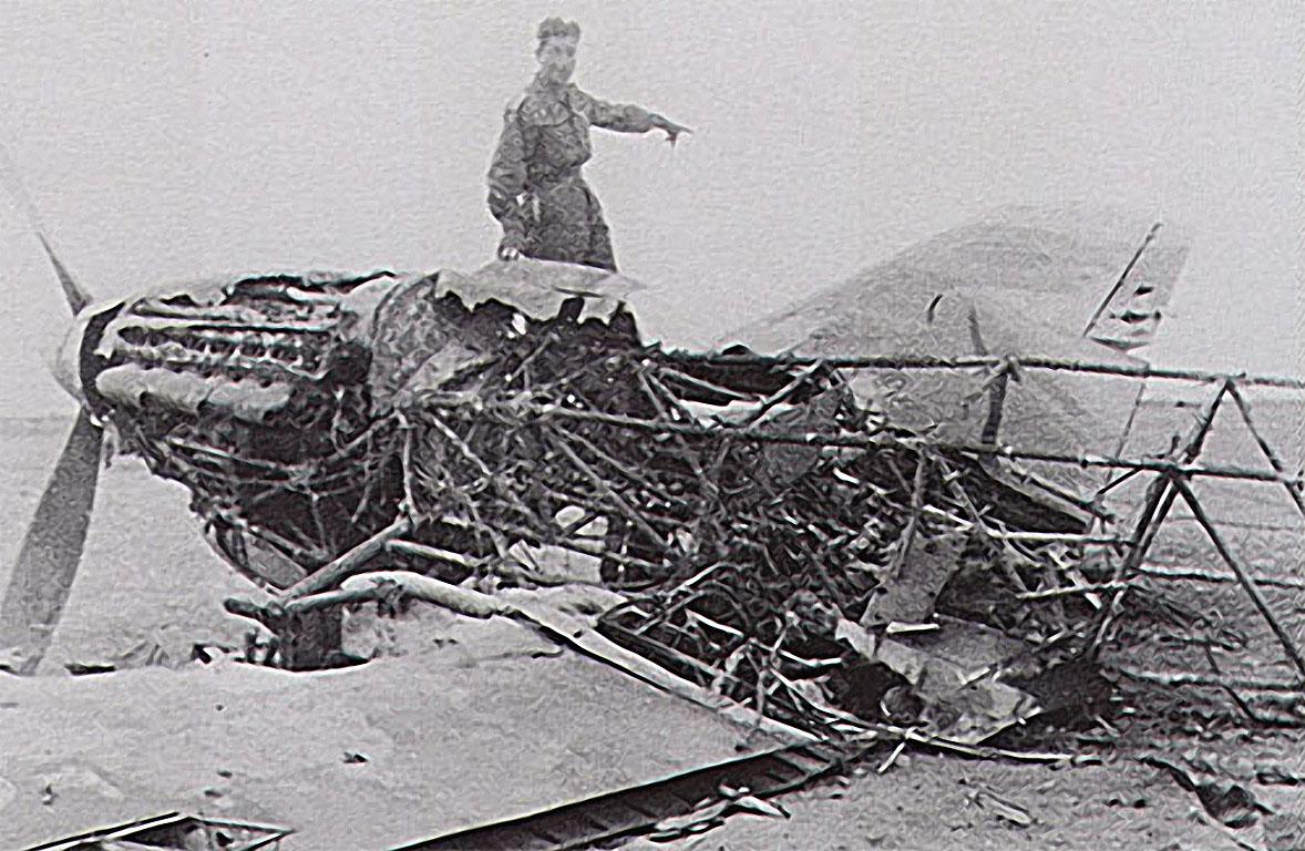 Luftwaffe JG27 pilot Albert Espenlaub exams a downed Hurricane North Africa 01