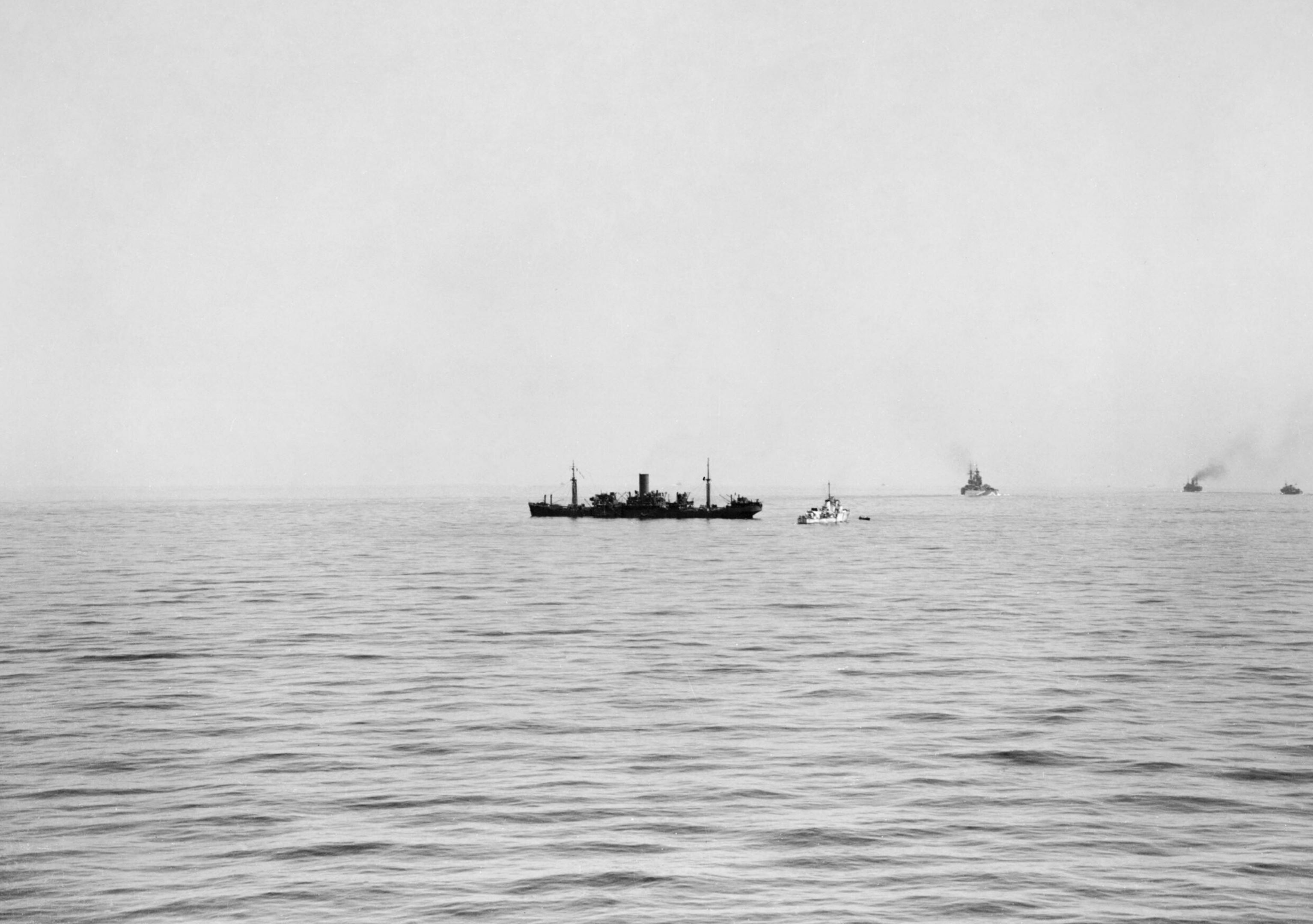 Destroyer possibly HMS Bramham with merchant ship SS Deucalion after been bombed Aug 1942 IWM A11188
